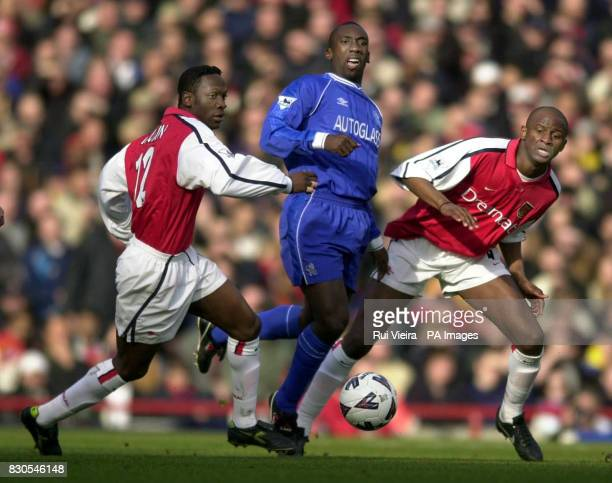 Arsenal's Lauren and Patrick Vieira block Chelsea's Jimmy Floyd Hasselbaink during the FA Cup Fifth Round football match at Highbury London