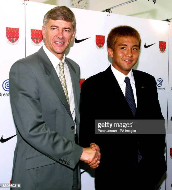 Arsenal's new signing from JLeague club Gamba Osaka Junichi Inamoto and Arsenal's manager Arsene Wenger pose for the media at a photo call at London...
