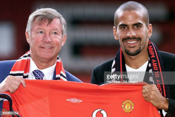 Manchester United's new signing Juan Sebastian Veron poses for photographers with manager Sir Alex Ferguson at Old Trafford Mancheste Veron completed...