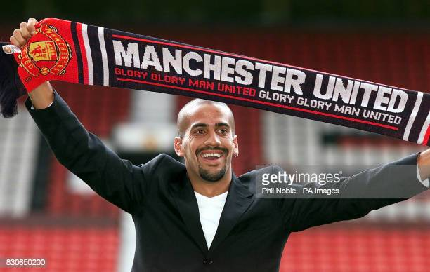 Manchester United's new signing Juan Sebastian Veron poses for photographers following a press conference at Old Trafford Manchester Veron completed...