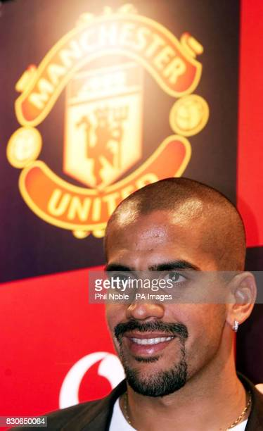 Manchester United's new signing Juan Sebastian Veron talks to the media during a press conference at Old Trafford Manchester Veron completed his...