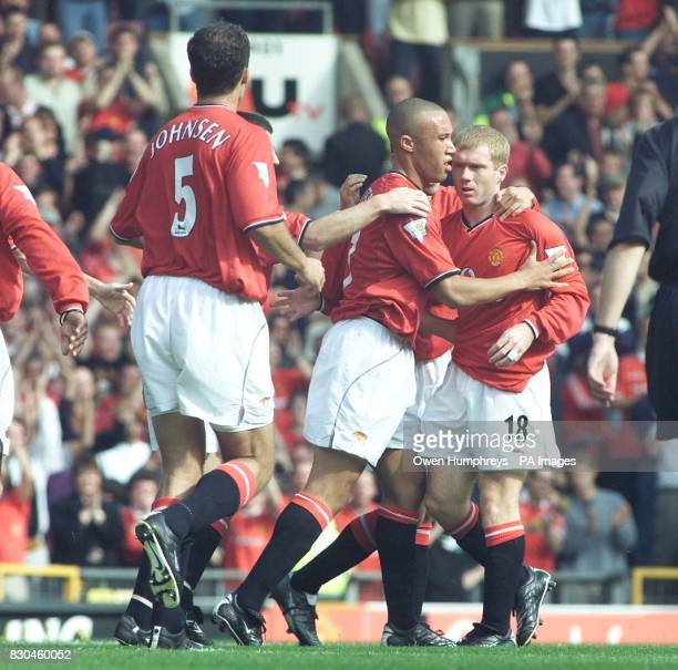Paul Scholes is congratulated by Mikael Silvestre on his equalizer agaisnt Chelsea at the FA Premiership match held at Old Trafford Manchester