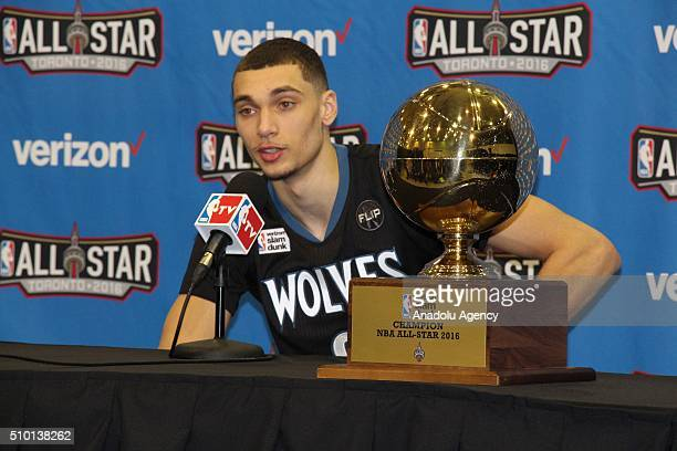 NBA league's Minnesota Timberwolves player Zach LaVine gives a speech with his trophy during a press conference after he won he Verizon Slam Dunk...