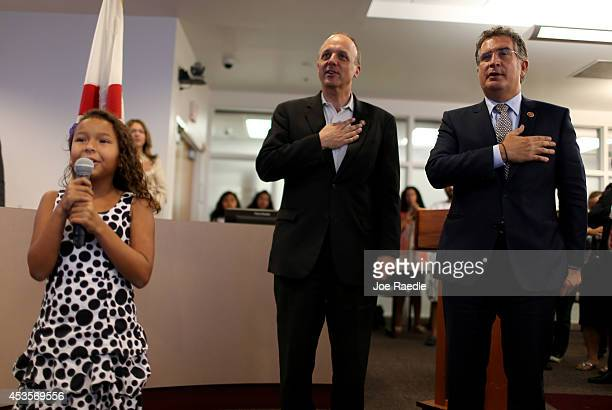 Leah Cayasso whose family originally came from Nicaragua leads the Pledge of Allegiance as US Rep Ted Deutch and Rep Joe Garcia hold an Immigration...