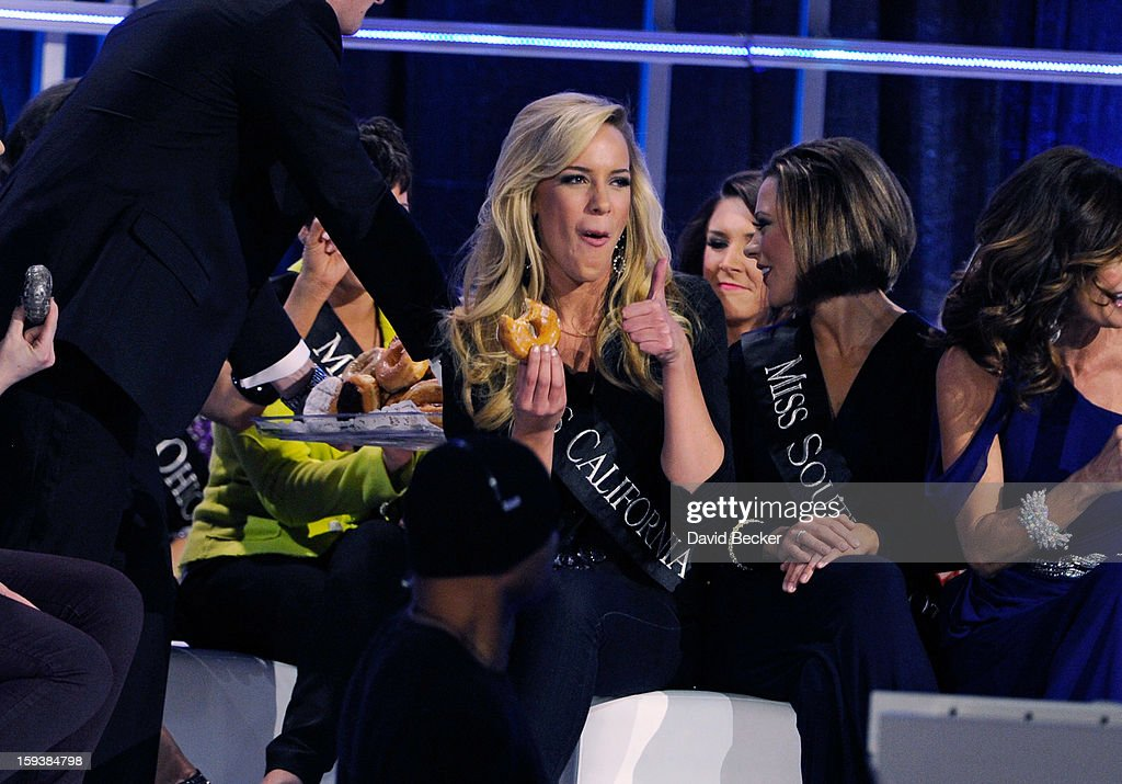 Leah Cecil, Miss California, gives a thumbs up as she takes a bite of a donut that were passed out to eliminated contestants during the 2013 Miss America Pageant at PH Live at Planet Hollywood Resort & Casino on January 12, 2013 in Las Vegas, Nevada.