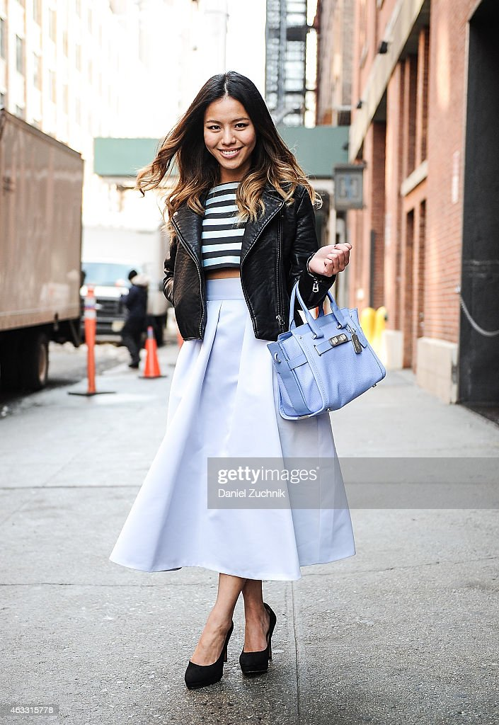 Leah Ho is seen outside the Marissa Webb show wearing a Rag and Bone jacket Tibi skirt Topshop top and Coach bag on February 12 2015 in New York City