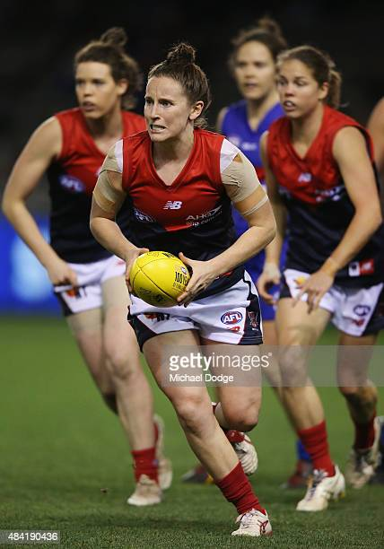 Leah Mascall of the Demons runs with the ball during a Women's AFL exhibition match between Western Bulldogs and Melbourne at Etihad Stadium on...