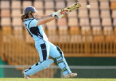 Leah Poulton of New South Wales plays a shot during the WT20 match between Tasmania and New South Wales at the NTCA Ground on October 25 2013 in...