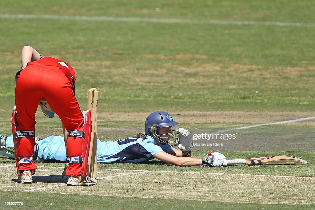 Leah Poulton of the Breakers lies on the ground after avoiding being run-out during the women's Twenty20 match between the South Australia Scorpions and the New South Wales Breakers at Prospect Oval on December 21, 2012 in Adelaide, Australia.