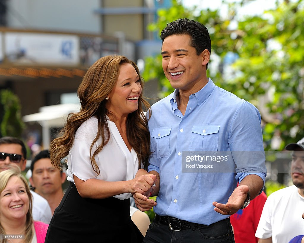 Leah Remini (L) and Mario Lopez visit 'Extra' at The Grove on April 29, 2013 in Los Angeles, California.