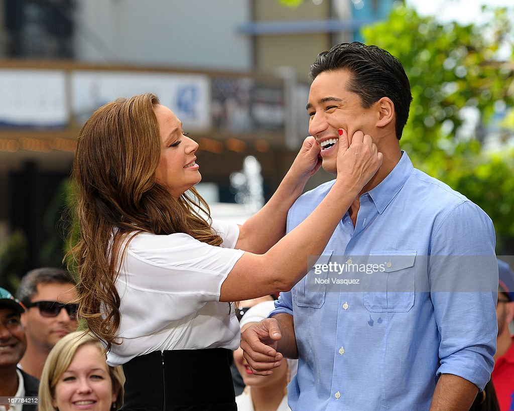 Leah Remini (L) and Mario Lopez's visit 'Extra' at The Grove on April 29, 2013 in Los Angeles, California.