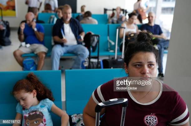 Leah Rocca cries in the San Juan Airport in Puerto Rico beside her 5 year old sister Kaylee as they wait for a flight to Atlanta where they will move...
