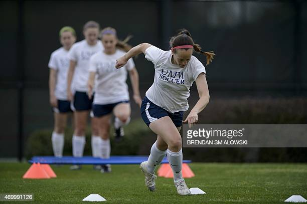 Leah Roth performs running drills with members of the University of Mary Washington Women's Soccer April 16 2015 at the University of Mary Washington...