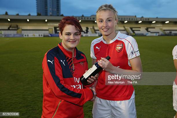 Leah Williamson of Arsenal is presented with the Player Of The Match award by a representative from the Arsenal Ladies Supporters Club during the WSL...