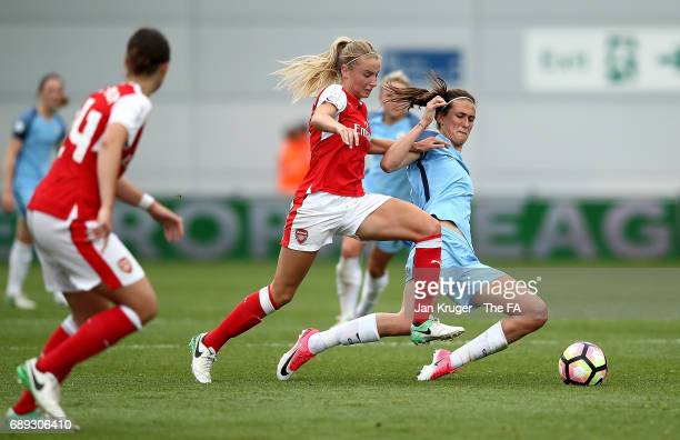 Leah Williamson of Arsenal Ladies battles with Jill Scott of Manchester City Women during the WSL 1 match between Manchester City Ladies and Arsenal...