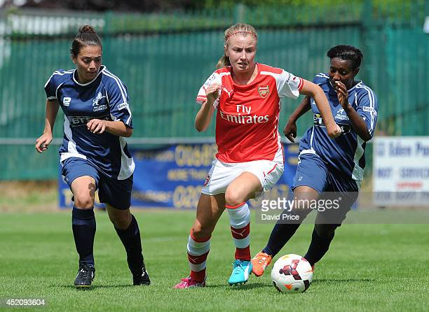 Leah Williamson of Arsenal Ladies bursts between Lilly Maple and Cherelle Albert of Millwall on her way to scoring Arsenal's 3rd goal during the...