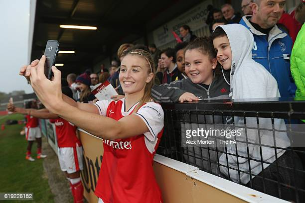 Leah Williamson of Arsenal takes a selfie with fans after the WSL 1 match between Arsenal Ladies FC and Doncaster Rovers Belles at Meadow Park on...