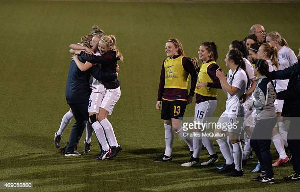 Leah Williamson of England celebrates with team mates after a retaken last minute penalty during the UEFA U19 Women's Qualifier between England and...