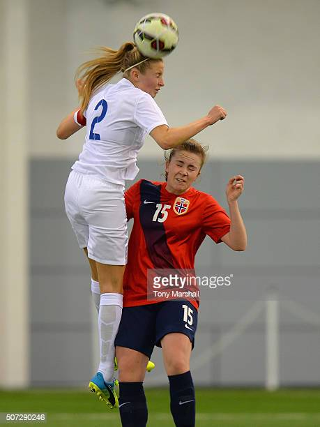 Leah Williamson of England wins the ball in the air from Marthe Enlid of Norway during the U19 Women's Friendly match between England U19 Women and...