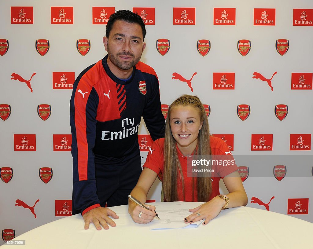 Leah Williamson signs a new long term contract with Arsenal Ladies with Arsenal Ladies Manager Pedro Martinez Losa at London Colney on July 30, 2015 in St Albans, England.