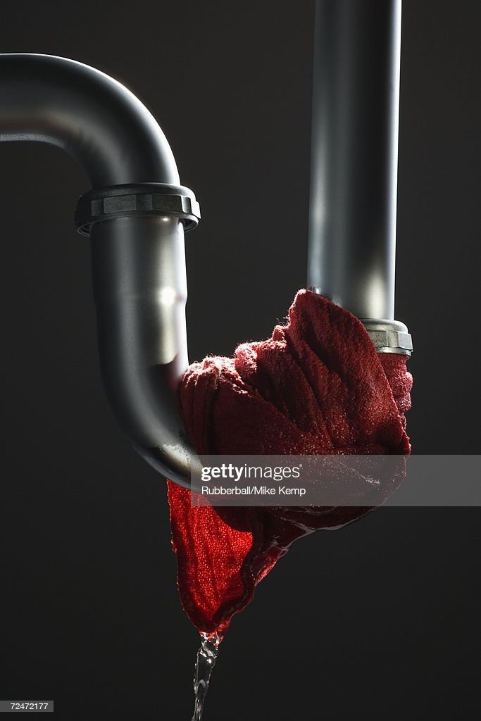 Leaking pipe with dripping rag : Stock Photo