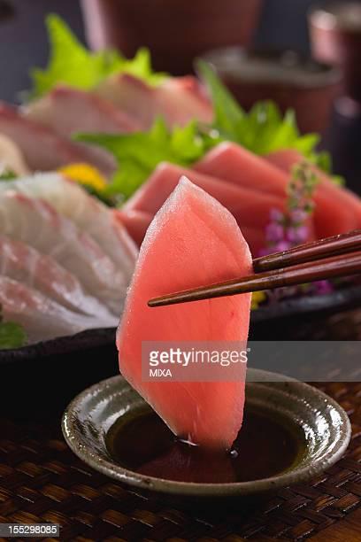 Lean Tuna Sashimi Dipped into Soy Sauce