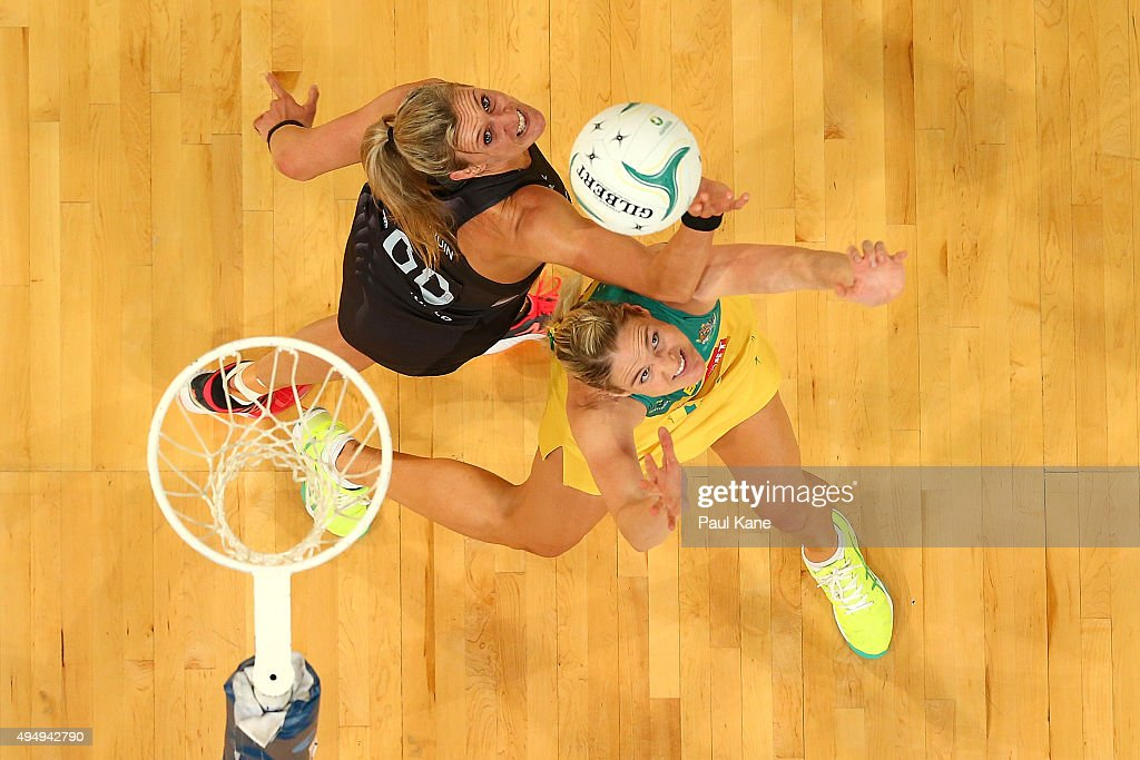 Leana de Bruin of New Zealand and Caitlin Bassett of Australia contest for the ball during the International Test Match between the Australian...