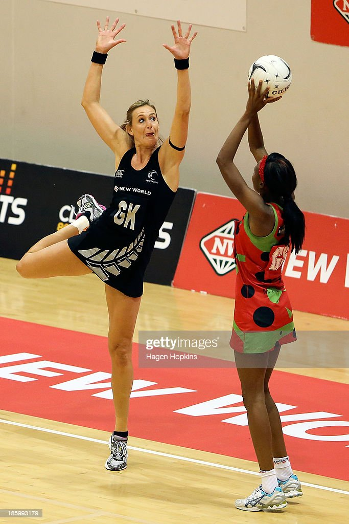 Leana de Bruin of New Zealand defends against Mwai Kumwenda of Malawi during the International Test Match between the New Zealand Silver Ferns and the Malawai Queens at Pettigrew Green Arena on October 27, 2013 in Napier, New Zealand.