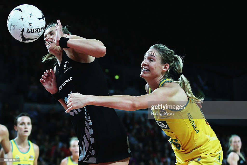Leana de Bruin of the Silver Ferns competes with Caitlin Bassett of the Diamonds for the ball during game two of the Constellation Series between the New Zealand Silver Ferns and the Australian Diamonds at Vector Arena on September 19, 2013 in Auckland, New Zealand.