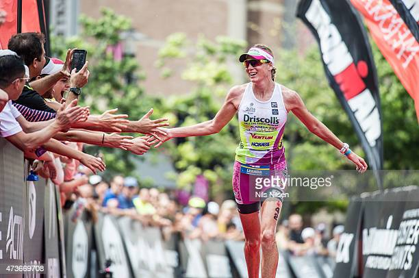 Leanda Cave from Great Britain celebrates second place at the IRONMAN North American Championship May 16 2015 in The Woodlands TX