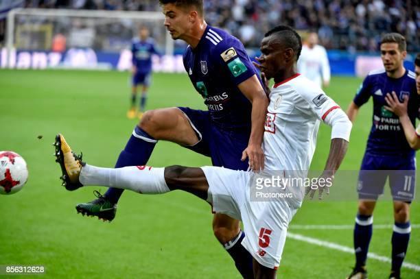 Leander Dendoncker midfielder of RSC Anderlecht and Uche Agbo defender of Standard Liege during the Jupiler Pro League match between RSC Anderlecht...