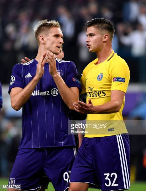 Leander Dendoncker midfielder of RSC Anderlecht with the shirt of Dani Alves and Lukasz Teodorczyk forward of RSC Anderlecht during the Champions...