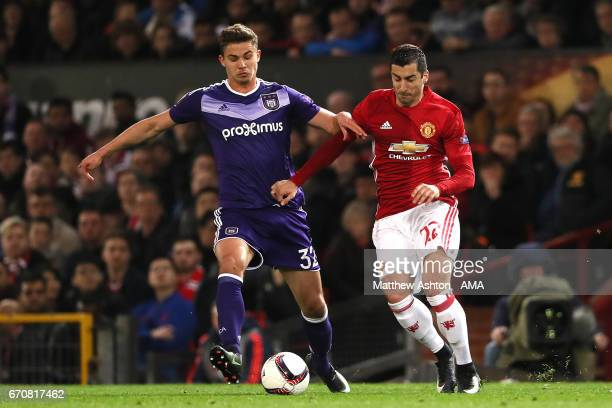 Leander Dendoncker of Anderlecht competes with Henrikh Mkhitaryan of Manchester United during the UEFA Europa League quarter final second leg match...