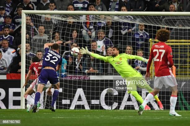 Leander Dendoncker of Anderlecht heads the ball to score his side's first goal during the UEFA Europa League quarter final first leg match between...