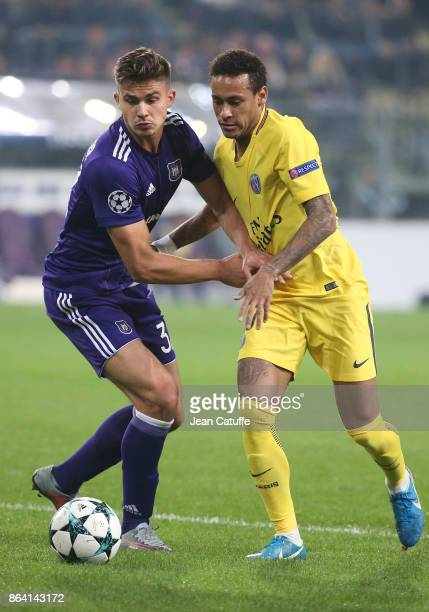Leander Dendoncker of Anderlecht Neymar Jr of PSG during the UEFA Champions League match between RSC Anderlecht and Paris Saint Germain at Constant...