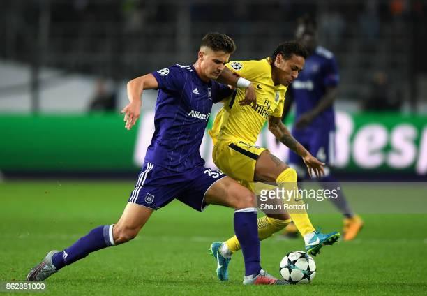 Leander Dendoncker of RSC Anderlecht and Neymar of PSG battle for possession during the UEFA Champions League group B match between RSC Anderlecht...