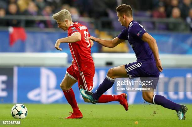 Leander Dendoncker of RSC Anderlecht and Robert Lewandowski of Bayern Muenchen battle for possession during the UEFA Champions League group B match...