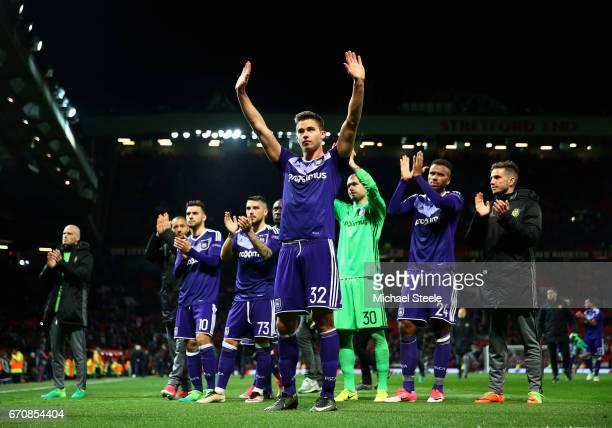 Leander Dendoncker of RSC Anderlecht and team mates salute the travelling fans after the UEFA Europa League quarter final second leg match between...