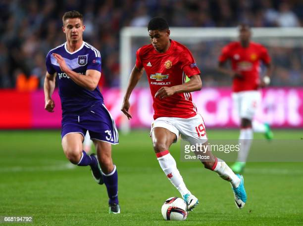 Leander Dendoncker of RSC Anderlecht chases Marcus Rashford of Manchester United during the UEFA Europa League quarter final first leg match between...