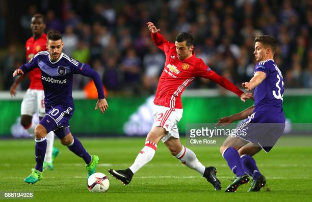 Leander Dendoncker of RSC Anderlecht closes down Henrikh Mkhitaryan of Manchester United during the UEFA Europa League quarter final first leg match...