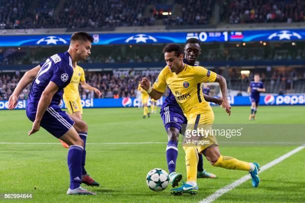 Leander Dendoncker of RSC Anderlecht Neymar da Silva Santos Junior of Paris SaintGermain Dennis Appiah of RSC Anderlecht during the UEFA Champions...