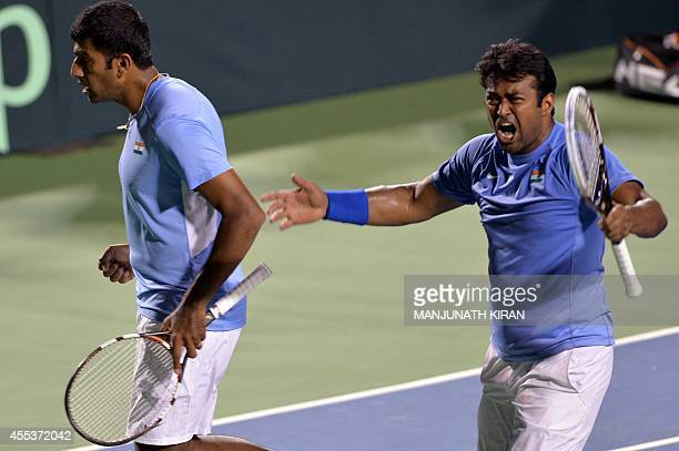 Leander Paes and his partner Rohan Bopanna of India exult as they score during the men's doubles match against Ninad Zimonjic and Ilija Bozoljac of...
