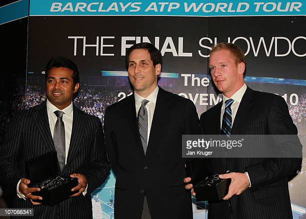 Leander Paes and Lukas Dlouhy receive their trophies from CEO of the ATP Adam Helfant during the Barclays ATP World Tour Finals Media Day at the...