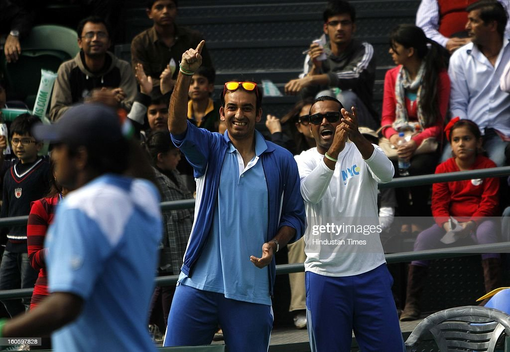 Leander Paes and Purav Raja cheers for VM Ranjeeth of India during Davis cup reverse single match against Jeong Suk Young of Korea at Delhi Lawn Tennis Association stadium on February 3, 2013 in New Delhi, India.