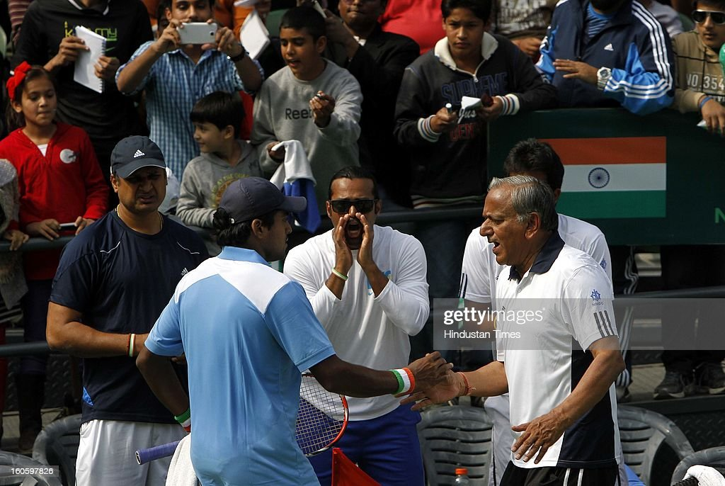 Leander Paes cheers for VM Ranjeeth of India during Davis cup reverse single match against Jeong Suk Young of Korea at Delhi Lawn Tennis Association stadium on February 3, 2013 in New Delhi, India.