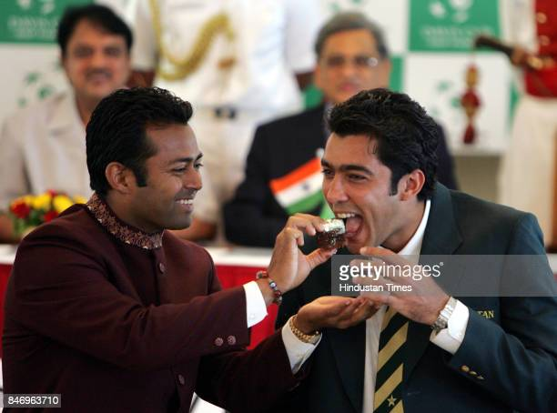 Leander Paes feeds cake to Aisam Ul Haq Qureshi of the Pakistan tennis team to celebrate the birth of his baby girl The Davis Cup draw ceremony was...