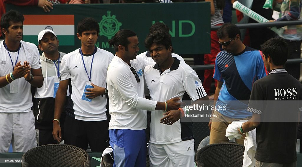 Leander Paes hugs VM Ranjeeth of India after losing the Davis cup reverse single match against Jeong Suk Young of Korea at Delhi Lawn Tennis Association stadium on February 3, 2013 in New Delhi, India.