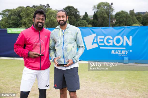 Leander Paes of India and Adil Shamasdin of Canada win the Mensdoubles trophy on June 24 2017 in Ilkley England