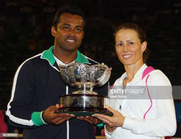 Leander Paes of India and Cara Black of Zimbabwe pose with the championship trophy after their mixed doubles final match against Ekaterina Makarova...