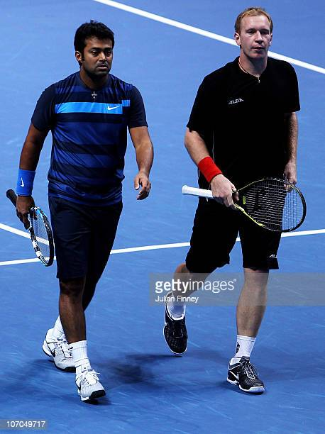 Leander Paes of India and Lukas Dlouhy of Czech Republic walk on the court during their men's doubles first round match against Mariusz Fyrstenberg...